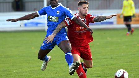 Declan Rogers does battle for Wisbech Town in the draw with Glossop North End last Saturday. Picture