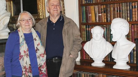 Graham and Margaret Blankley at Wisbech Museum with two plaster heads sculpted by his ancestor Pelle