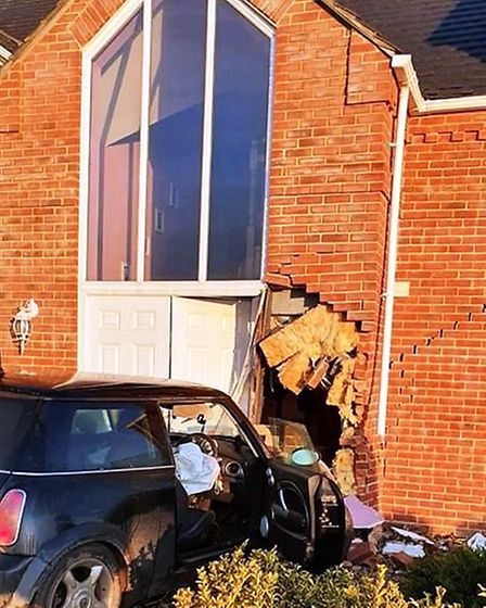 Extensive damage to house in Gorefield today after Mini careers into home. Picture; POLICING FENLAND