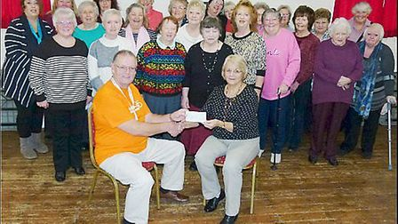 The fundraising ladies of Walpole Art & Craft Club donating the cheque to a Magpas representative at