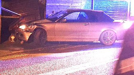 The BMW driver slammed his convertible 3 Series into a parked car before colliding with a fence on S