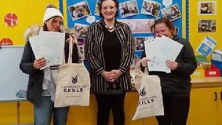 Parents from St Peter's C of E Junior school in Wisbech are breaking barriers by completing courses.