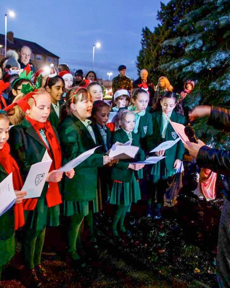 A choir from Stormont School singing at the light switch on. Picture: Christian Grey.