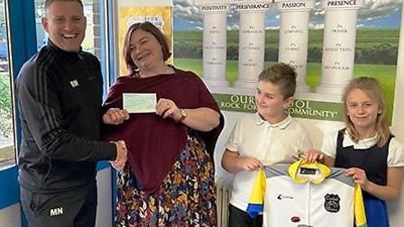 Mark (left) at the cheque presentation at St Peter's Junior School in Wisbech. Picture: MARK NORRIS