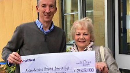 Marie Humphrey handed over a £2,000 cheque to the Addenbrooke's Charitable Trust to Dr Philip Butter