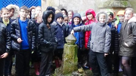 Pupils at Anthony Curton & Tilney All Saints discover the grave of Wisbech legend Tom Hickathrift. P