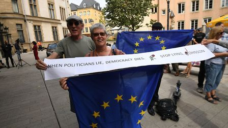 Protesters outside Le Bouquet Garni restaurant in Luxembourg. Photograph: Stefan Rousseau/PA Wire.