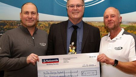 Tydd St Giles Golf Club donate thousands to Fen homeless charity The Ferry Project. Club vice-captai