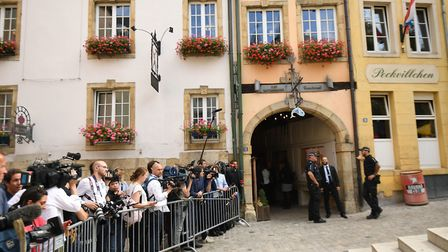 Protesters and the media outside Le Bouquet Garni restaurant in Luxembourg. Photograph: Stefan Rouss