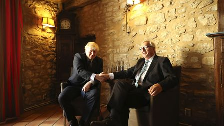 European Commission President Jean-Claude Juncker, right, shakes hands with British Prime Minister B