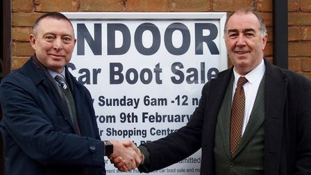 Kevin Smith (left), manager of Wisbech's Horsefair Shopping Centre, shakes hands with Les Donohue-Br