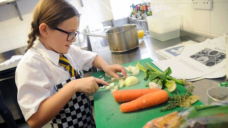 A pupil cooking as part of the Young Chef award. Picture: Rob Lock