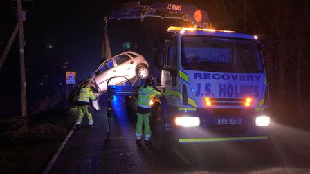 A driver had a lucky escape after their car ended up upside down and underneath an electricity pole