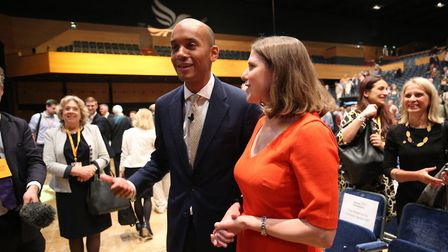 Chuka Umunna (left) is joined by Jo Swinson (right) following his speech during the Liberal Democrat