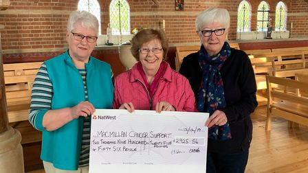 Parson Drove fundraisers Casey Bates, Isabelle Johnson and Pam Judge donated a cheque for £2,905 to