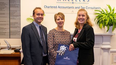 Debbie Chaplain (centre) is celebrating 25 years working at Wheelers Chartered Accountants firm in W