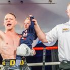An emotional nigh for Lee (far right) with Michael Walsh and his son Liam Picture: MARK HEWLETT