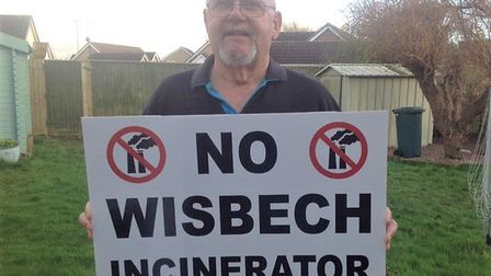 Mike Bucknor pictured holding one of the placards to be held by campaigners at the rally. Picture: W