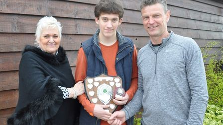 Harry Goldspink (centre) with the Peter Peukert Memorial Trophy alongside Fay Peukert (left) and clu