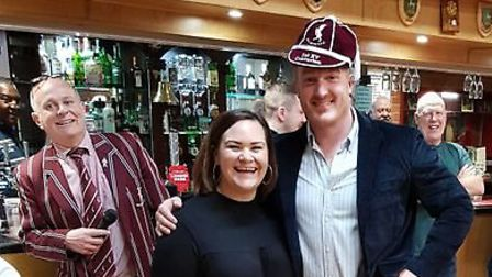 Dan Atkinson receives his cap from Rachel Elliott, sister of the captain who gave him his first one,