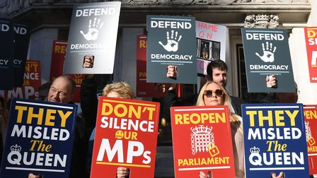Protesters outside the Supreme Court in London where judges are due to consider legal challenges to Boris Johnson's...