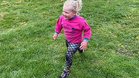 Isla Newsome along with cousins Flo and Bella are running one kilometre every day around their garde
