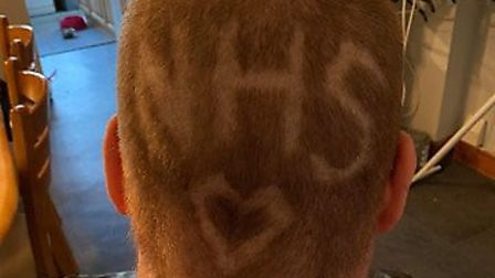Abie Davis had NHS shaved into the back of her head to raise funds for NHS staff.