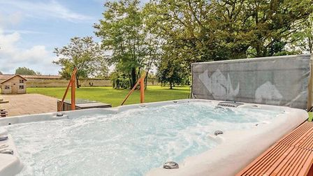 The accommodation at Lode Hall Country Park in Three Holes boasts hot tubs with stunning views of th