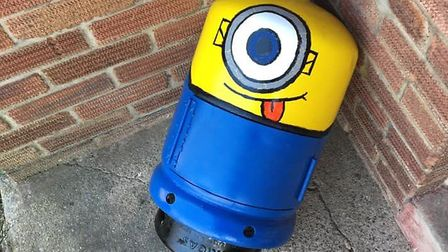 Scott Hudson and his daughter Shanice turned an old rusty gas bottle into a vibrant Minion and plan