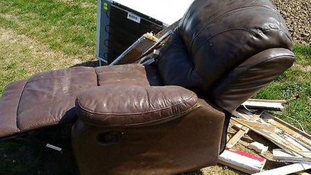 Fly tipped armchair and other items at Tydd St Giles, Picture; TWITTER