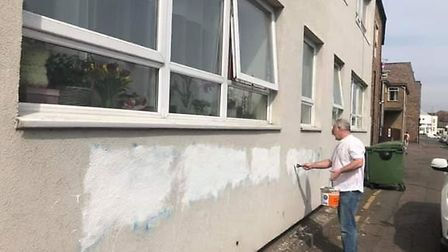 Racist graffiti that appeared overnight on block of flats in Wisbech was hastily removed by local t