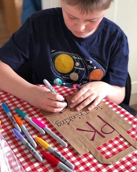 Kenan Catchpole-Mateu decorating bags for the project. Picture: Potential Kids.