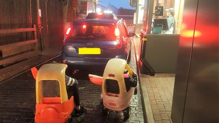 Two children were spotted trying their luck at McDonald's drive-thru in Wisbech in two ride-on plast