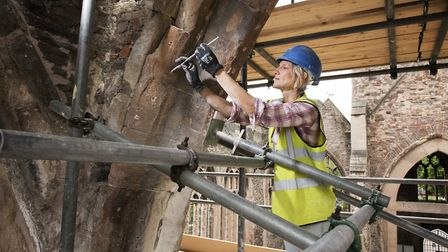 A building conservator working on a church. Picture: James O. Davies / Historic England