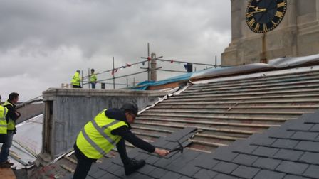 Work on repairing a roof. Historic England has announced a COVID-19 Heritage at Risk Response Fund t