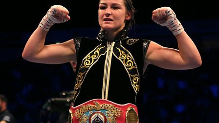 Katie Taylor celebrates victory against Christina Lindardatou in their WBO super-lightweight world t