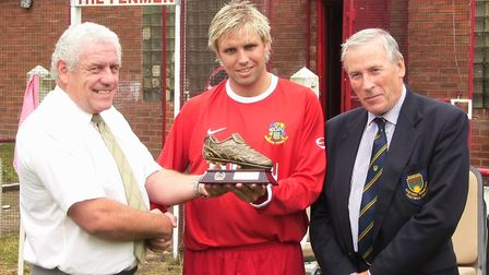 Wisbech Town player Liam Harrold (centre) receives the golden boot for the 2005-06 season. Picture: