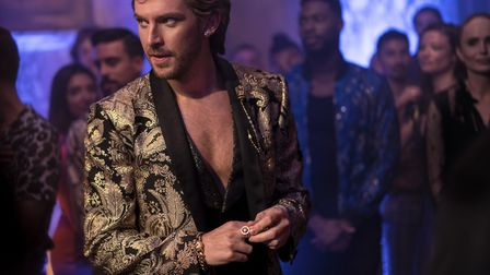 Dan Stevens as Alexander Lemtov hosts a party in Eurovision Song Contest: The Story of Fire Saga. Pi