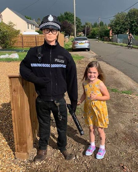 One of Lucy Bryant's children with PC Crow. Picture: Lucy Bryant
