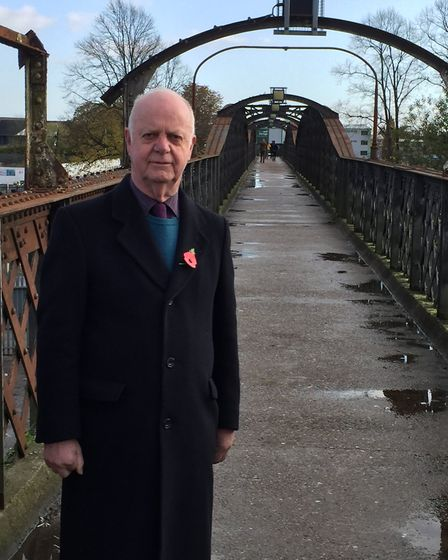 Malcolm Cowan, Liberal Democrat group leader and a Peartree councillor, on the railway bridge. Picur