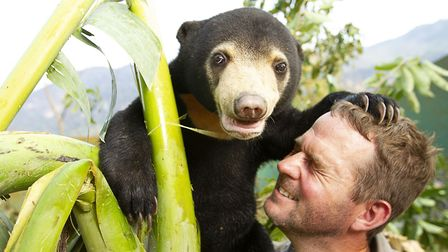 Mary the Sun Bear with Giles Clark in Bears About The House. Picture: BBC/Tom Jarvis