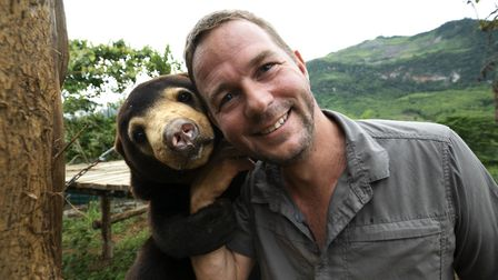 Giles Clark with Mary the Sun Bear in Bears About The House. Picture: BBC/Cherique Pohl