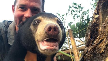 Giles Clark with Mary the Sun Bear in BBC Two's Bears About The House. Picture: Supplied by Paradise