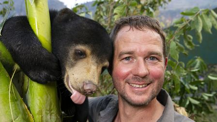 Giles Clark and Mary the Sun Bear at the Free the Bears sanctuary in Laos. Picture: BBC/Tom Jarvis