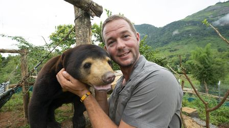Giles Clark with Mary the Sun Bear, after her move to a large enclosure at the Free the Bears Sanctu