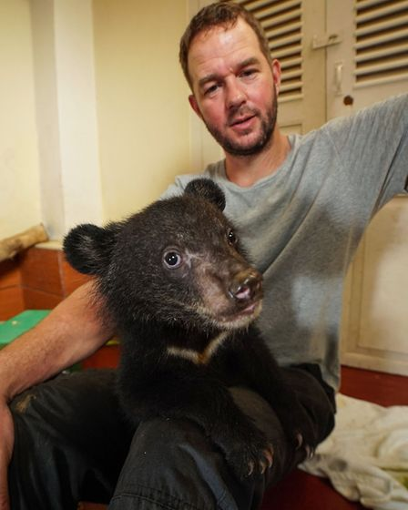 With Moon Bear cub Jane. Picture: BBC/Cherique Pohl