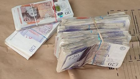 Tobacco worth £3 million and £12,000 in cash were seized in a raid at an illegal processing factory