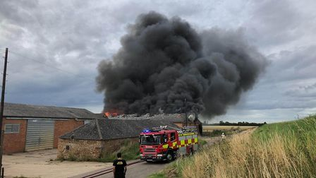Four crews of firefighters were called to tackle a blaze at farm buildings in Mouth Lane, Wisbech St