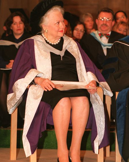Olivia de Havilland holding her Honorary Degree of Doctor of Letters certificate, awarded by the Uni