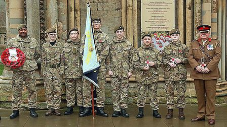 Colonel Mark Knight MBE LD (Right) joins cadets participating in the Royal British Legion parade. Pi